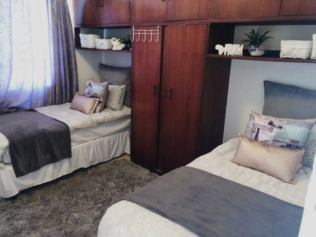 Option 2 - 2 x single beds for a sharing duo