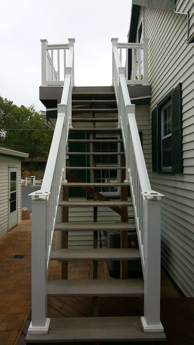 Stairs to private balcony & entrance.