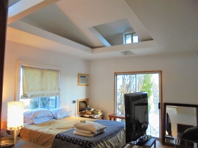 Bedroom in artist's home.   Or rent entire house.