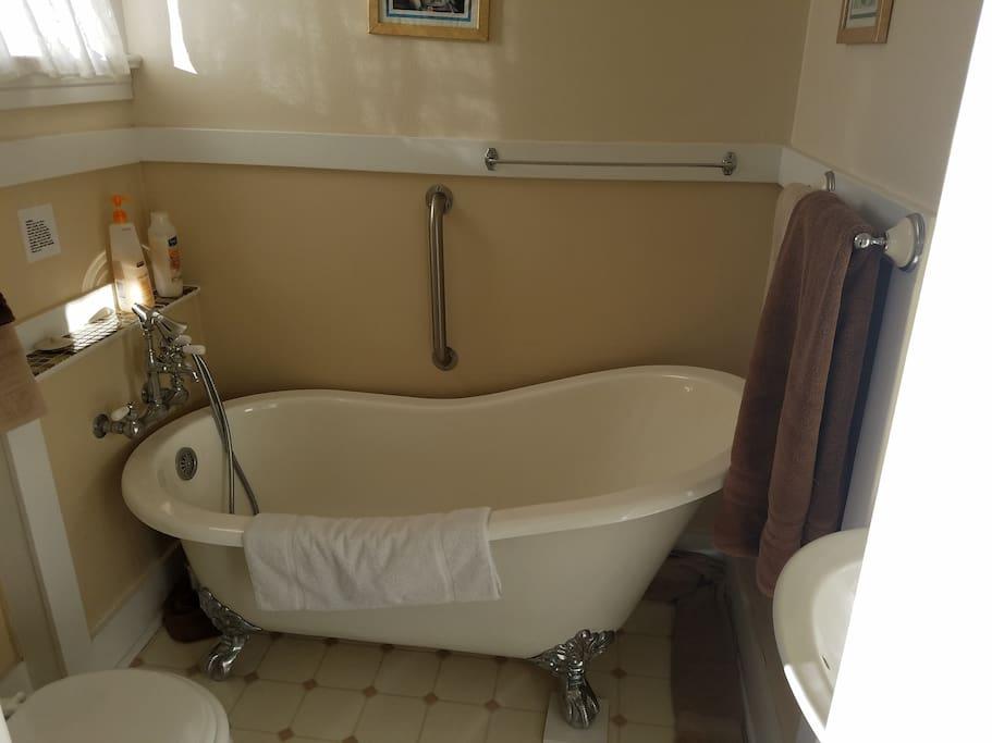 Private en suite bathroom with a claw foot soak tub (no shower)