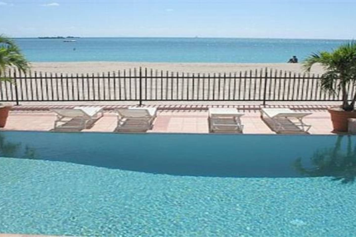 This is your view while lounging in the pool! Once outside the fence you are 50 ft. to the Ocean!