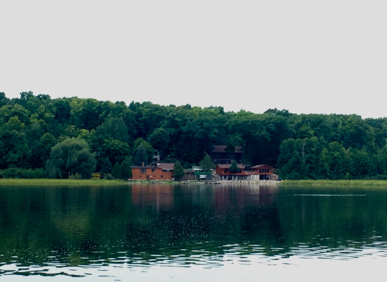 Piacenza cabins are the 2 cabins pictured on the right; Johnnie's Resort are the 2 on the left.  Surrounded by the Nicolet National Forest.  This is the ONLY development on 500-acre Wabikon Lake that leads to 250-acre Riley Lake then on to Indian Springs.  All of these waterways are federally and state protected!  Its rare to find a Wisconsin lake like this.  Fish and boat to your delight and leisurely relax attempting to unplug.