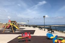 Playground and cafe behind Mellieha church. Fantastic sea and country views, excellent ice cream and teas. 10minute walk....cafe umbrellas visible from my balcony.
