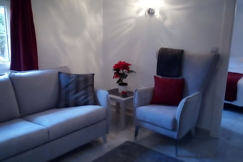 Lounge..with TV. Sofa converts into double bed