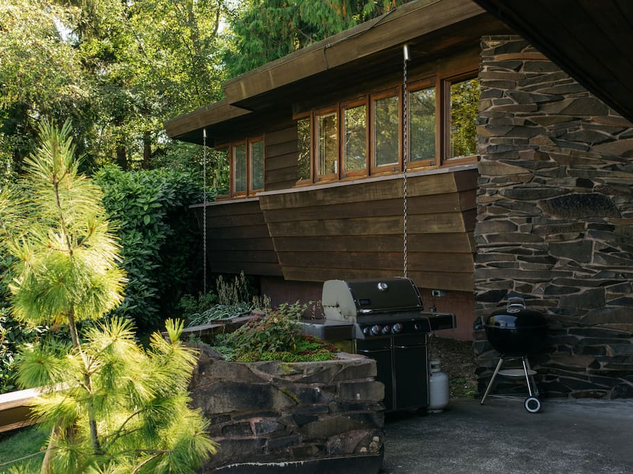 We have both propane and charcoal grill options. View of cabin windows which face the water.