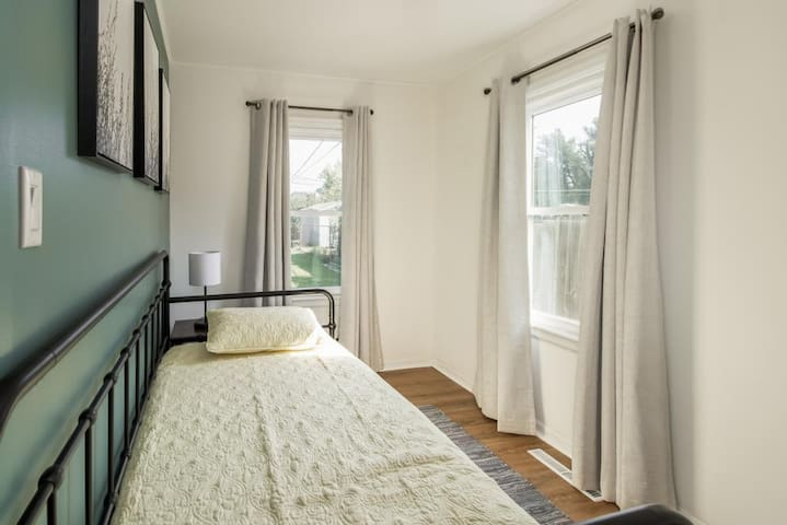 Second bedroom features a twin bed and twin trundle.