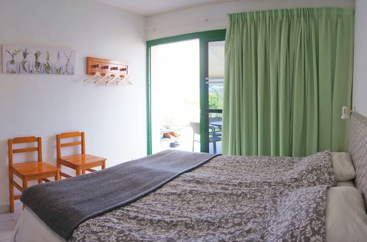 Bedroom with access to terrace.