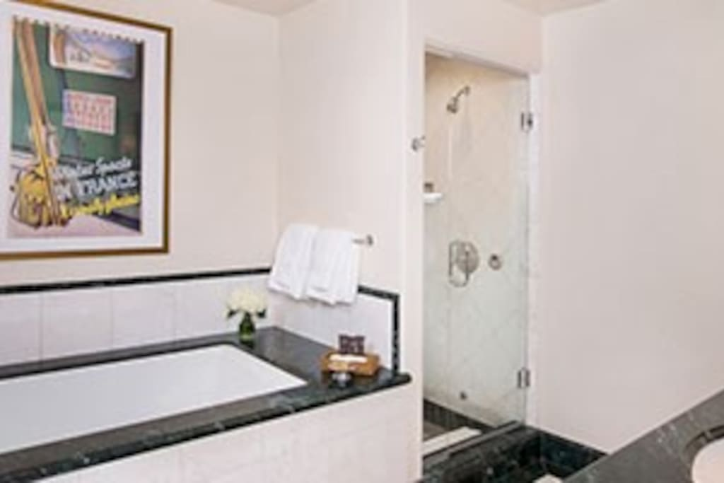 Pamper yourself in the 5-piece marble bathroom, complete with TV and plush bathrobes.