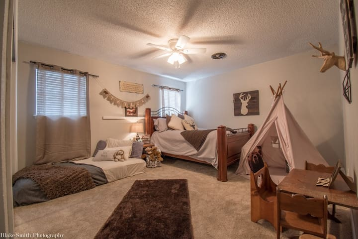Downstairs bedroom with twin size bed and queen size bed with comfy down comforter!