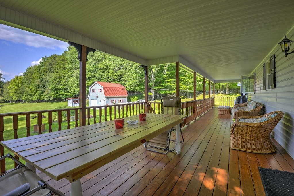 Savor a delicious meal al fresco at the picnic table on the spacious, covered deck.