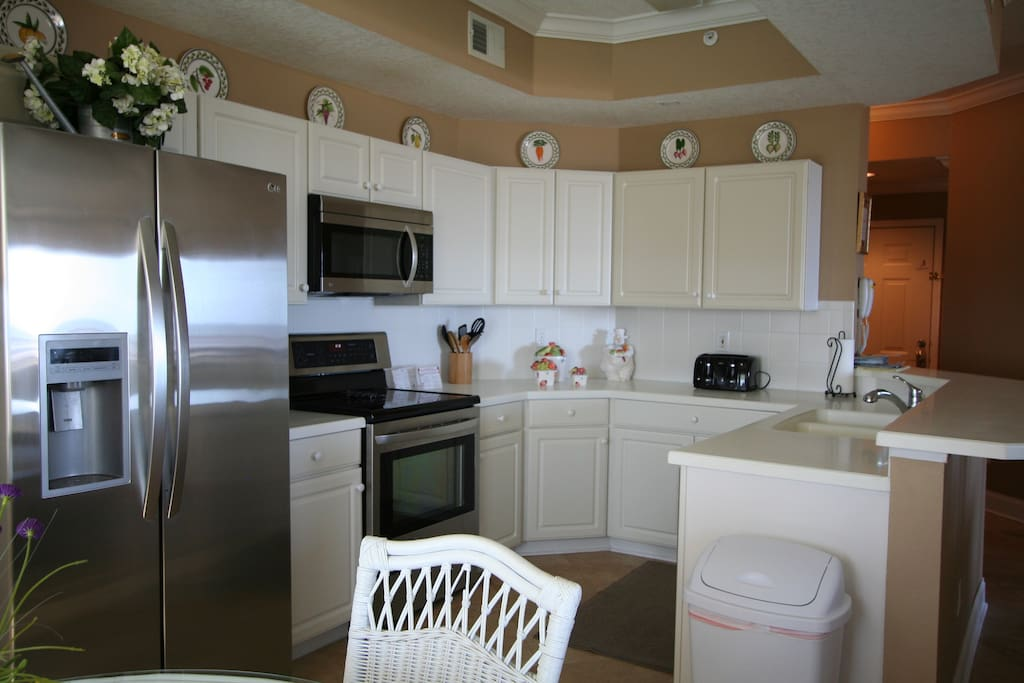 Kitchen that opens into family room and dining room.  Also, connects to breakfast nook that overlooks the ocean.