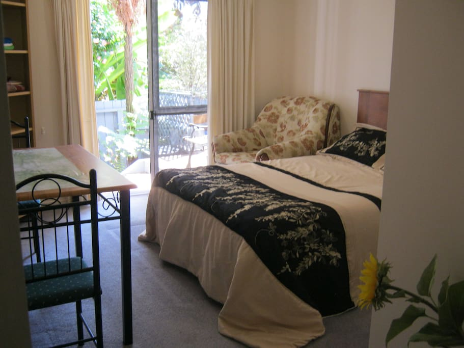 Lovely airy room with double bed for couples which looks onto the deck