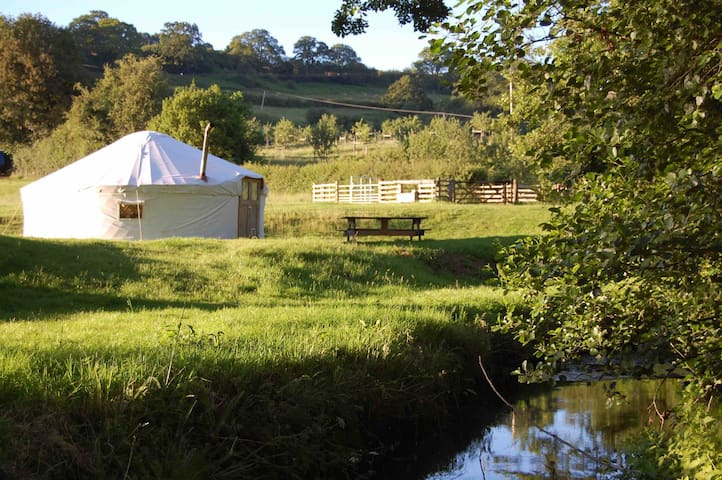 Family yurt in exclusive riverside setting