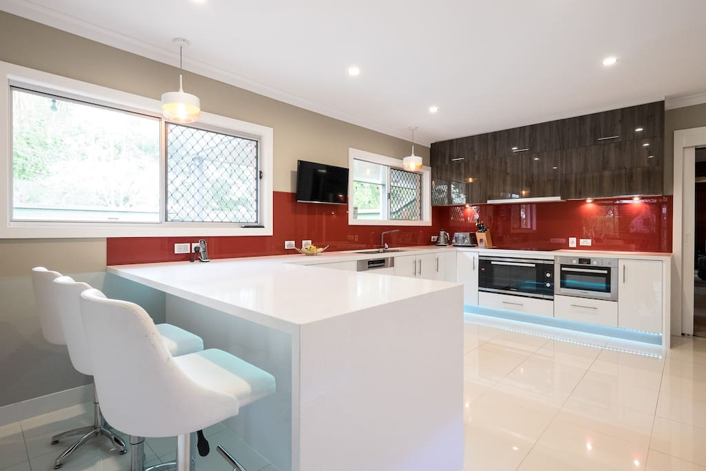 Our new modern kitchen with funky color under cupboard lighting.