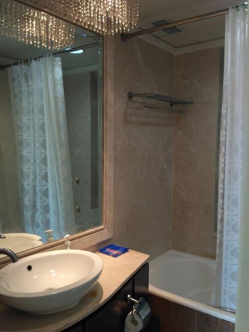 Bathroom with bathtub, heater
