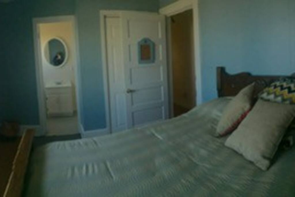 Bedroom with full size bed, with a long distance ocean view. The carnival view in summer months