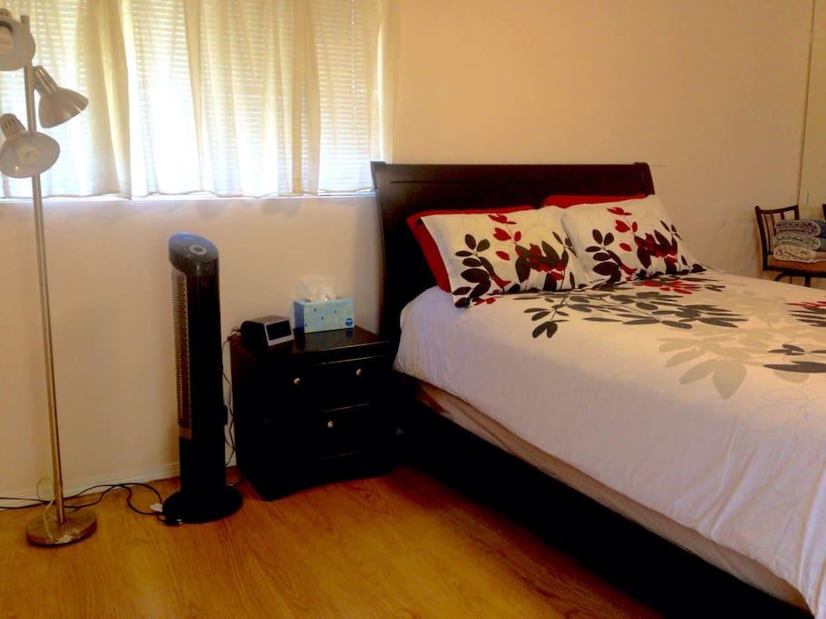 Queen bed with fan.
