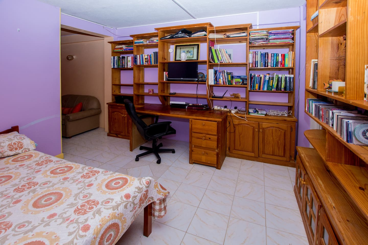 Study space, office desk and chair, bookshelves galore