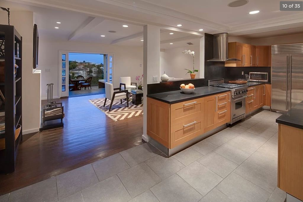 A true masterpiece kitchen with views of Hollywood from the counter top through the living room and the 2nd story patio