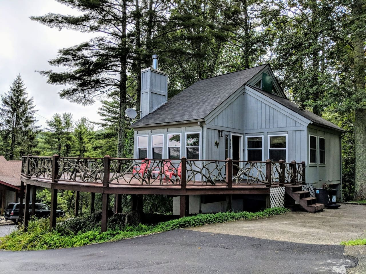 Front of House, lots of character with a driftwood deck railing.