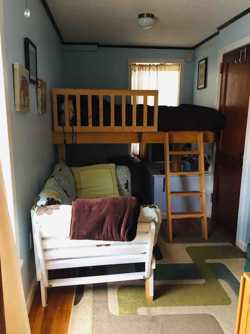 This shows the loft bed and loveseat futon that folds down into an extra single bed