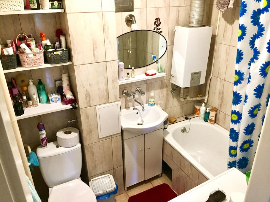 clean bathroom with cleaning supplies