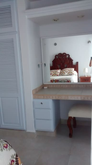 Large vanity with mirror.