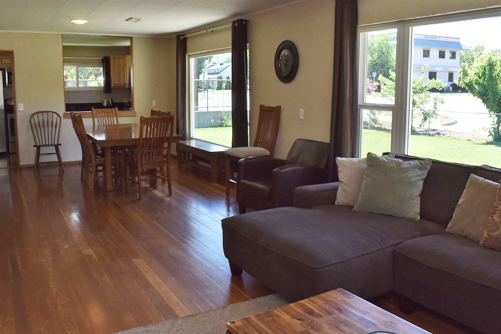 Large open living and dining areas with lots of windows