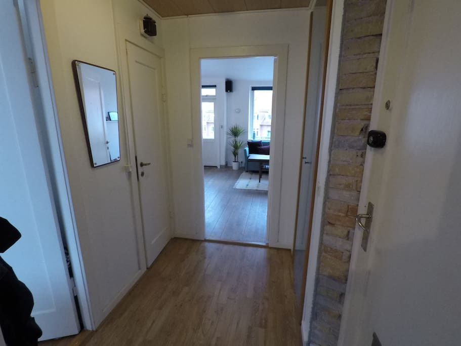 The entrance. From left to right you see the entrances to bedroom, bathroom, living room and the entrance door.
