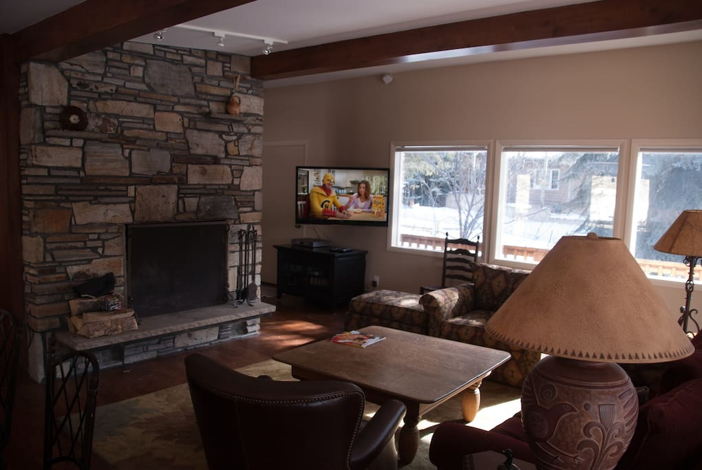 Two flat screen TVs upstairs and downstairs--