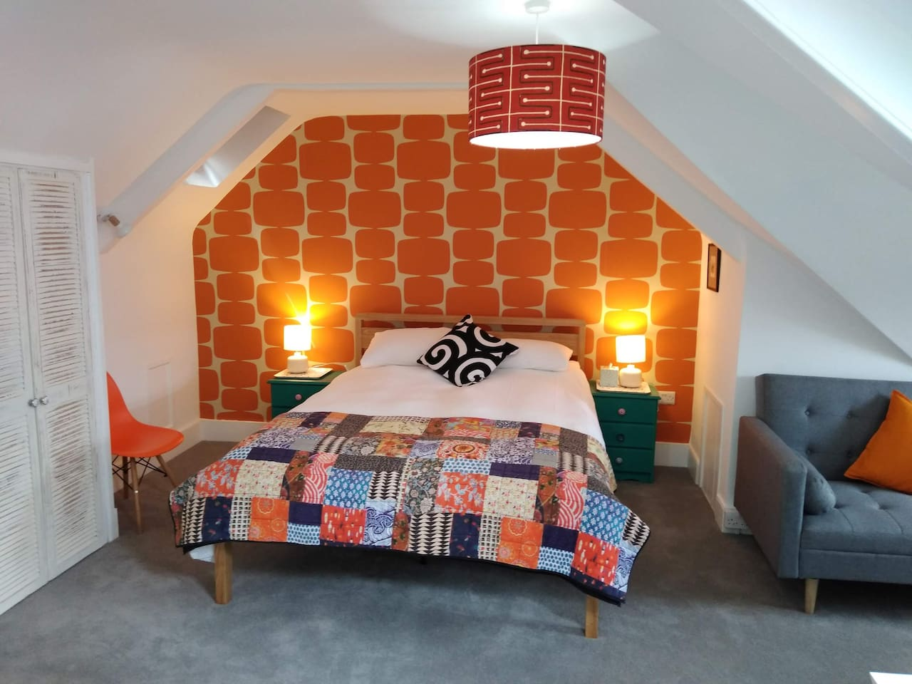 Bed with bold wallpaper!