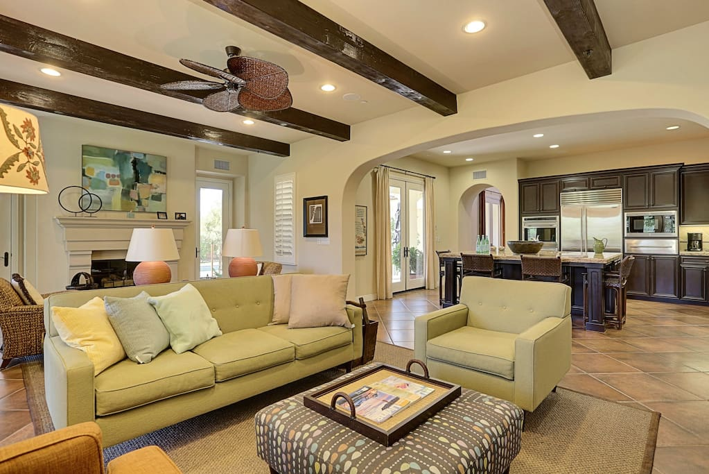 Spacious Living Room with High Beamed Ceilings