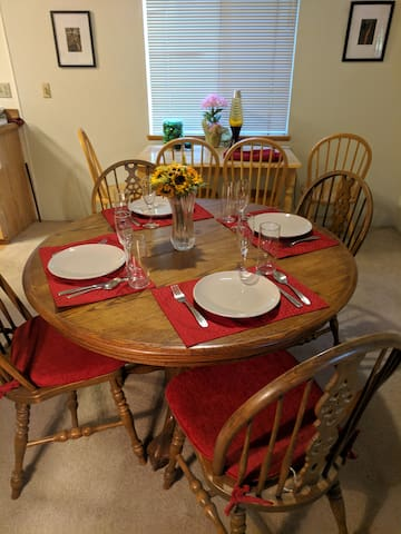 Dining room table has extension allowing dining for six.  Extra table is useful for computing and surfing the web.