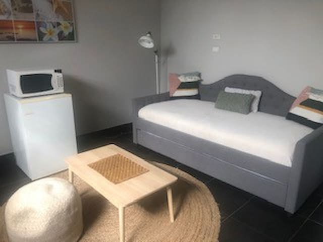 Bedroom 1:  Guest can enjoy relaxing in their own mini lounge area.  There is a mini fridge to store or refrigerate food, as well as, a microwave for your own use.