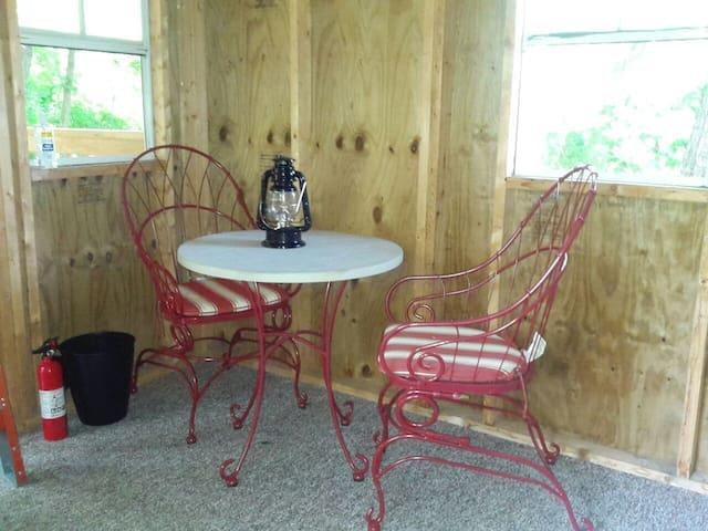 Small table inside. Picnic table outside.