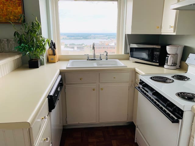 Cozy little kitchen. Look at that river out the window!
