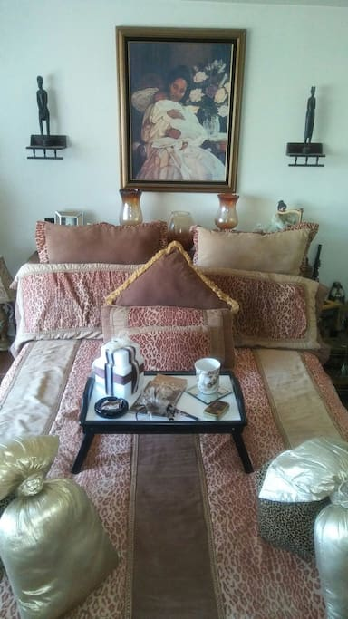 Queen Bed with firm mattress; breakfast tray.