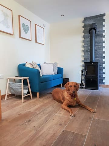 Living space with underfloor heading, woodburner, breakfast bar and kitchenette. Dog friendly!