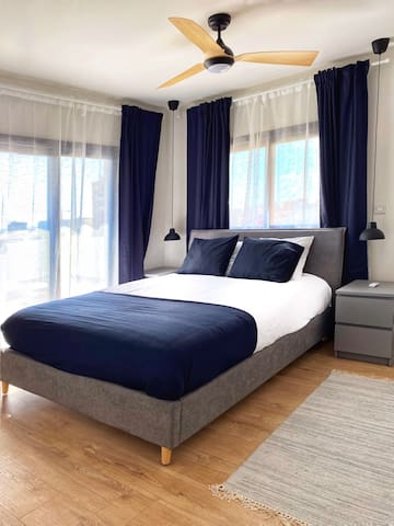 Master bedroom, with a queen size bed, with direct access to the southern terrace and a private wet room, consisting of fully renovated shower area and basin.