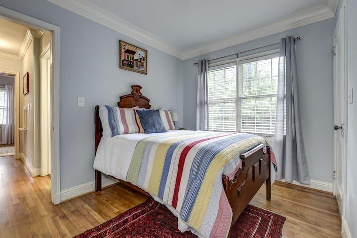 Third bedroom has an 1875 walnut bed overlooking the llamas and alpacas.