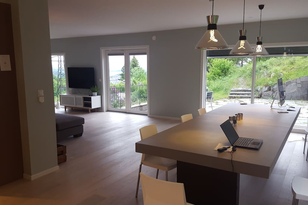 """Temp. picture from living room. Showing 330 cm long table (with eating space for up to 14 people), the TV, and also parts of the outside area. you can also soo glimpse of the """"Oslo fjord"""","""
