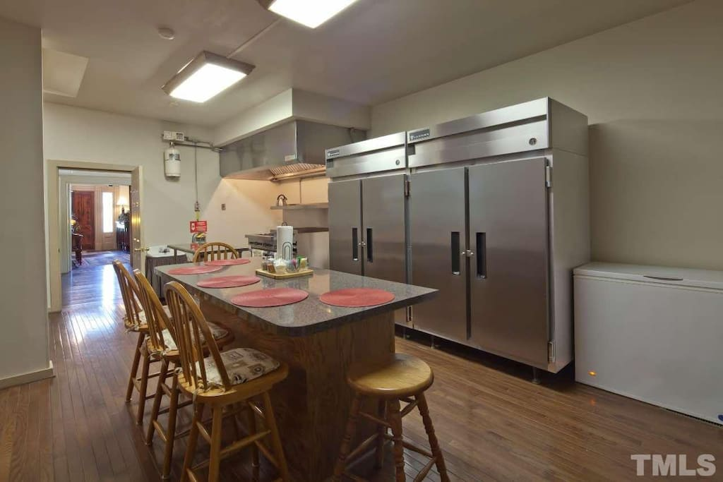 Commercial sized kitchen has gas stove with large double ovens, 6 burners, griddle top and broiler. The refrigerator can hold lots of your food for your stay and the chest freezer is ideal to keep bags of ice for your coolers.