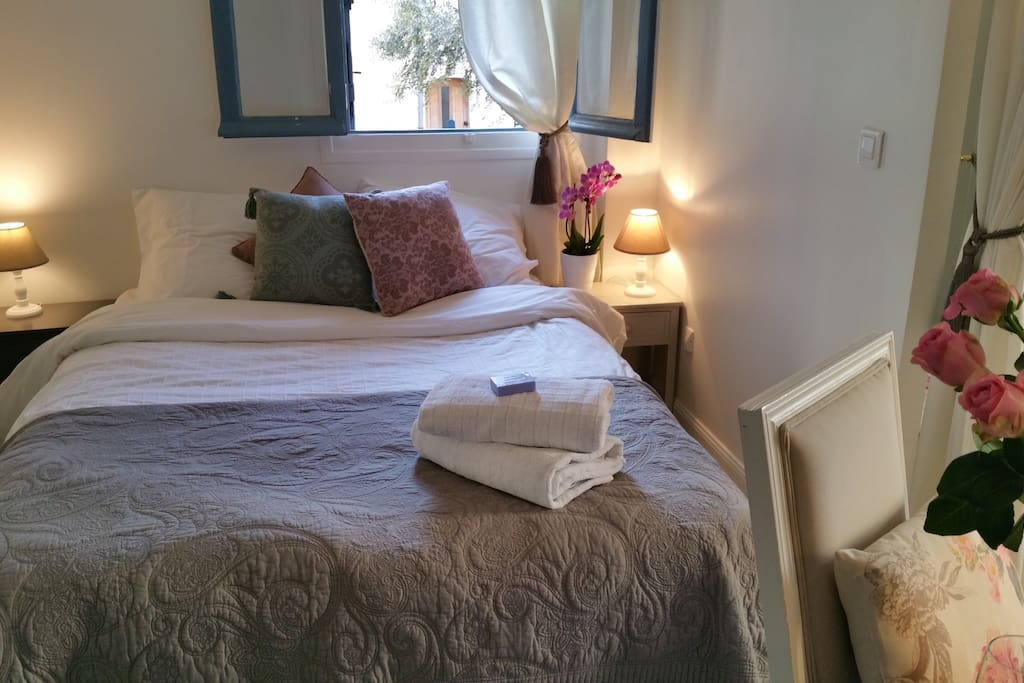 The cosy Bedroom looking over the olive tree