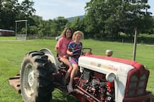 Learn to drive a tractor...now we might turn on the mower and put you to work :)