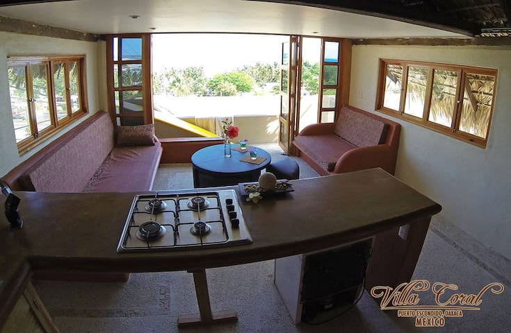 Equipped with a basic kitchen with a nice ocean view for your comfort
