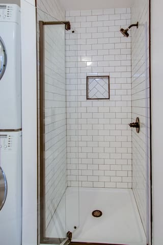 Clean and bright walk in shower in downstairs bathroom.
