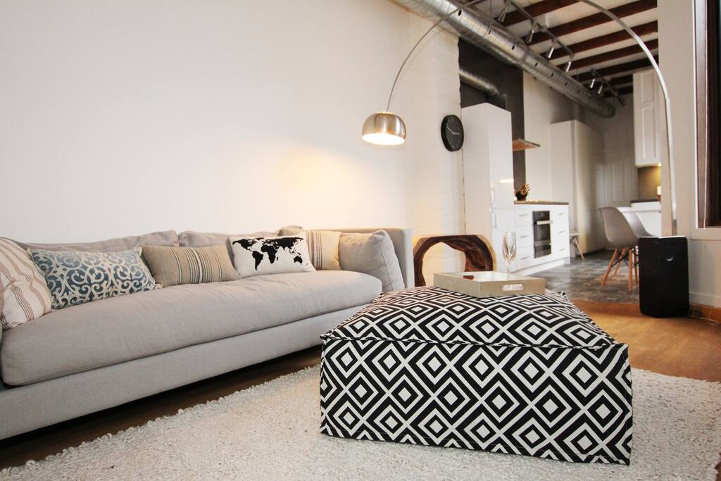 Industrial-chic style, with exposed wood beams and high ceilings throughout.