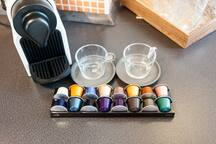 nespresso machine is provided with range of coffee pods as well as range of teas - green, darjeeling (black) and fruit teas