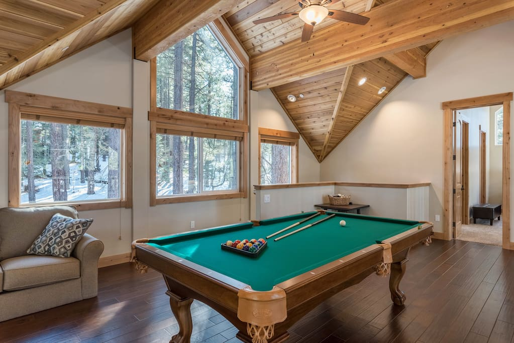 On the 3rd floor, vaulted ceilings soar above a game room with a pool table that can be converted into a ping-pong table.