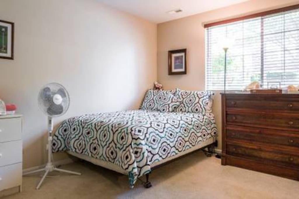 Private Bedroom: Private Full-size Bed; Chest of drawers; Stand-up fan; Nightstand; (Movable Cots not shown)